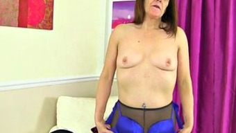 In English Gilf Pandora Fucks Her Pantyhosed Pussy With A Dildo