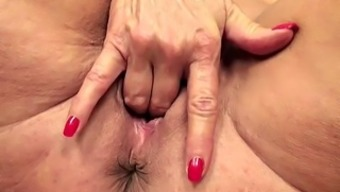 Busty Blonde Granny Hands Wrists And Fingers Her Stormy Pussy Located On The Flooring