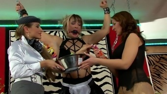 Femdom Lesbian Threesome With Chained Brown