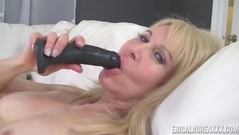 Erica Lauren Has Experience With Using A Dark Colored Dildo On Her Luke-Warm Pussy